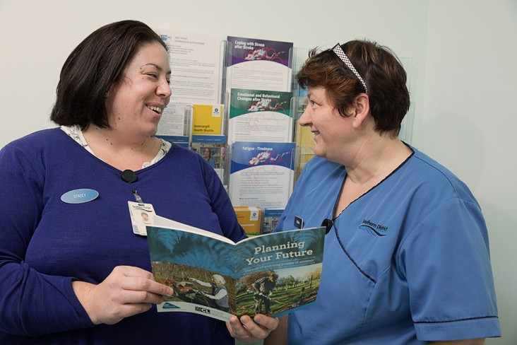 two women looking at health brochures