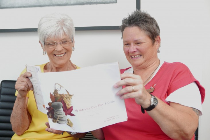 two women reading an Advanced Care Plan