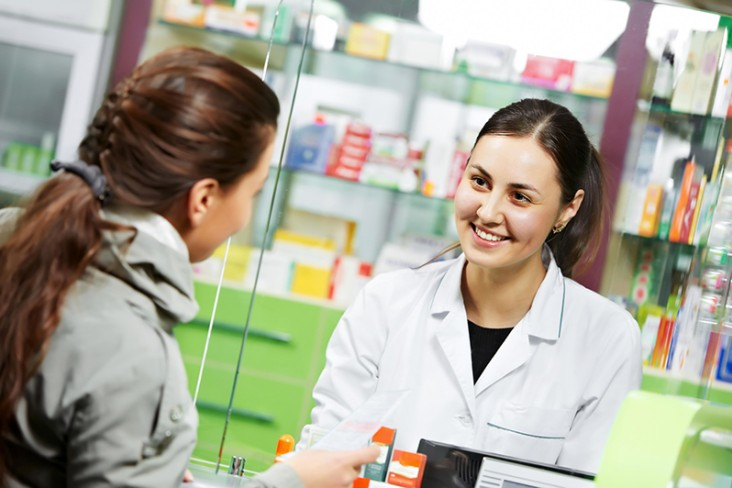 Woman serving customer at a pharmacy
