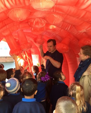 Dr Jason Hill walks pupils from New River Primary School through a giant inflatable bowel.