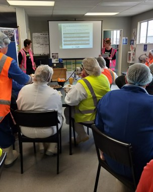 Workers at Sanford in Bluff gather to learn more about bowel screening